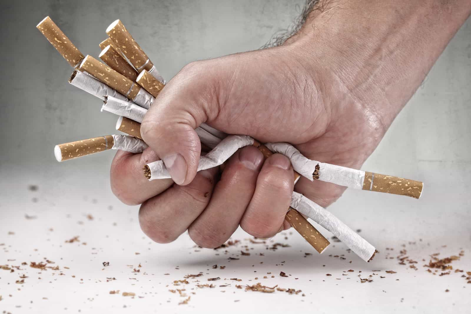 Man refusing cigarettes concept for quitting smoking and healthy