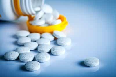 prescription medication spilled on table