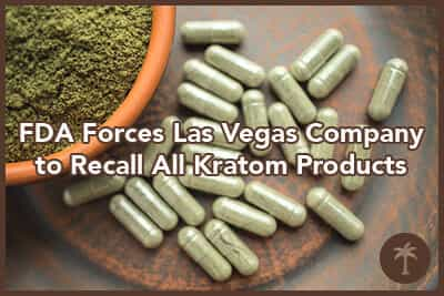 Supplement kratom green capsules and powder on brown plate.