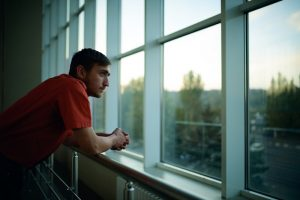 college graduate feeling isolated by his drug addiction after graduation