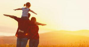 an alcoholic dad enjoys a sober afternoon with his family on father's day by enjoying the sunset instead of picking up a bottle of alcohol.