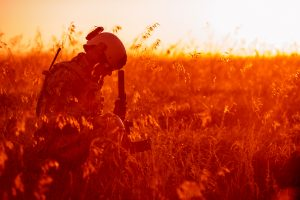 while sitting in a field, a veteran soldier struggles with ptsd and substance abuse
